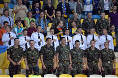 Ukrainian military in the stadium sing the anthem Stock Image