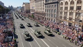 Ukrainian military vehicles drive during a military parade stock video