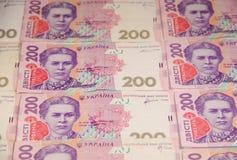 Ukrainian money. Background of two hundred hryvnia banknotes Stock Photos