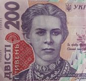 Ukrainian money. Banknote of Ukrainian hryvnia. Background of two hundred hryvnia banknotes, coins in piles, close-up stock images