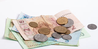 Ukrainian money. Ukrainian banknotes and coins on white background Stock Photos