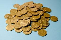 Ukrainian money on a blue background Royalty Free Stock Photos