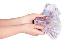 Ukrainian money fanned out in her hand Royalty Free Stock Photography