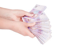 Ukrainian money fanned out in her hand Royalty Free Stock Image