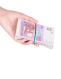 Ukrainian money fanned out in her hand Stock Image