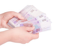 Ukrainian money fanned out in her hand Stock Photo