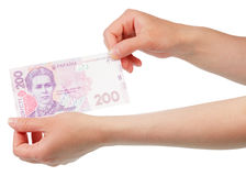 Ukrainian money in hand Stock Images