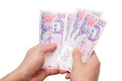 Ukrainian money in hand Stock Image