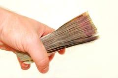 Ukrainian money in the hand isolated Stock Image