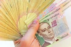 Ukrainian money in the hand Stock Photography
