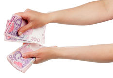 Ukrainian money in hands Royalty Free Stock Photo