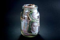 Ukrainian money in the jar Royalty Free Stock Photography