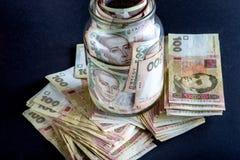 Ukrainian money in the jar Stock Photo