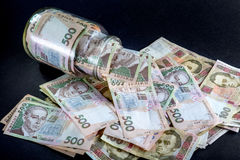 Ukrainian money in the jar Royalty Free Stock Image