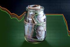 Ukrainian money in the jar Royalty Free Stock Photo