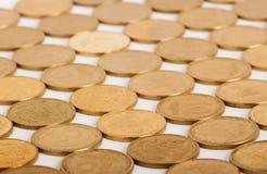 Ukrainian money. Pattern of many gold coins, ten ukrainian kopeck Royalty Free Stock Photos