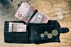 Ukrainian money in the wallet on black background. Ukrainian money in your wallet little my coins Royalty Free Stock Image