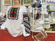 Ukrainian national clothes. Women`s shirts on the mannequin. Costume stock photos