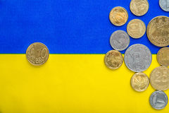 Ukrainian national coins and ten euro cents against the background of the national yellow-blue flag. Eurovision currency Stock Photo