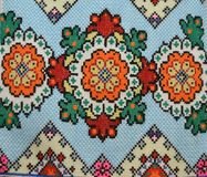 Embroidery in the form of diamond. Ukrainian national embroidery.Embroidery is made of green, yellow and blue threads royalty free stock photography