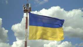 Ukrainian national flag against the sky. Ukrainian national flag against the blue sky stock video footage