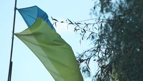 Ukrainian national flag against the sky. Ukrainian national flag against the blue sky stock footage