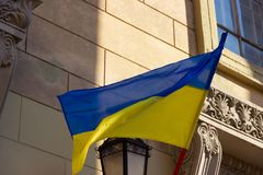 The Ukrainian national flag flutters over the entrance to the polling station.  presidential elections in Ukraine in 2019 royalty free stock photo