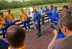 Ukrainian National football team. KHARKIV, UKRAINE - MAY 22: Yuriy Sapronov (C) greets Ukrainian National football team players during visit to Superior golf stock photos