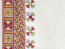 Ukrainian national hand embroidery on white linen. Ukrainian national hand cross-stitch embroidery on white homespun linen Royalty Free Stock Photos