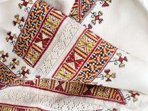Ukrainian national hand embroidery on white linen. Ukrainian national hand cross-stitch embroidery on white homespun linen Stock Photos