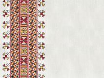Ukrainian national hand embroidery on white linen. Ukrainian national hand cross-stitch embroidery on white homespun linen Royalty Free Stock Image