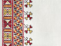 Ukrainian national hand embroidery on white linen. Ukrainian national hand cross-stitch embroidery on white homespun linen Royalty Free Stock Image