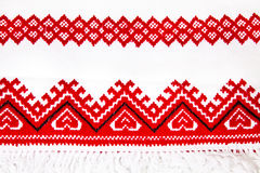 Ukrainian national ornament embroidery closeup. Ukrainian national red ornament embroidery close up Stock Photography