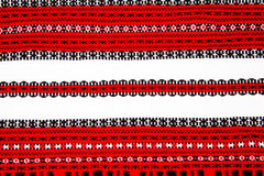 Ukrainian national red and black ornament embroidery closeup Royalty Free Stock Photo