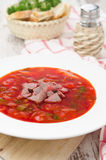 Ukrainian national red borscht on the plate vertical Stock Images