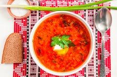 Ukrainian national red borscht with sour cream closeup Stock Image