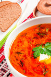 Ukrainian national red borscht with sour cream closeup Royalty Free Stock Photos