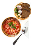 Ukrainian national soup. Ukrainian and russian national red soup with rye bread on white background Royalty Free Stock Image