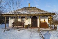 Ukrainian national wattle and daub  house on a farm. Ancient national adobe house on a farm in the winter. Poltava region. Ukraine Royalty Free Stock Photos