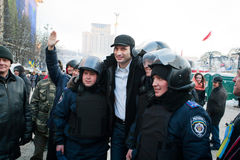 Ukrainian opposition politician Vitali Klitschko photographed with a detachment of policemen during anti-government protest Royalty Free Stock Images