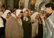 Ukrainian parishioners of the Orthodox Church. VOYUTYN, UKRAINE - 14 October 2008: Priest holding smoking incense during the religious celebration Pokrov Royalty Free Stock Image