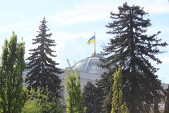 The Ukrainian Parliament with a Ukrainian flag on the roof stock photo