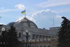 The Ukrainian Parliament with a Ukrainian flag on the roof royalty free stock photography