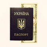 Ukrainian passport and cash on whine Royalty Free Stock Photos
