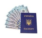 Ukrainian passport and  dollar bills over white Royalty Free Stock Photography