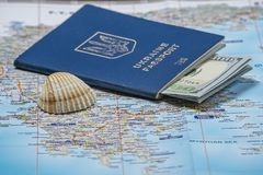 Ukrainian passport with dollars on a map background. Emigration kit for earnings or vacations stock images