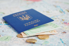 Ukrainian passport and money on map Stock Photos