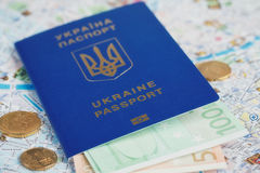 Ukrainian passport and money on map Royalty Free Stock Photography
