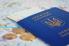 Ukrainian passport and money on map Royalty Free Stock Images