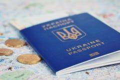 Ukrainian passport and money on map Stock Photography